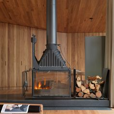 We've rounded up popular homes that use fireplaces to create cosy living spaces – including a Norwegian cabin and a Finnish winter retreat