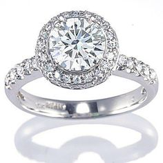 Diamond Engagement Ring Setting set with Round Brilliant cut Diamonds (0.65 ct. tw.) Available in 14k white or yellow gold. 18k white or yellow gold or platinum.