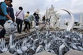 """""""Sculpture of the creatures of hell, sacrificial offerings, Wat Rong Khun temple or The White Wat, a Buddhist-Hindu temple by architect Chalermchai ..."""