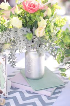 Silver spray-painted mason jars...Photography by thisloveofyours.com  Read more - http://www.stylemepretty.com/2013/06/11/whimsical-california-wedding-from-this-love-of-yours-photography/