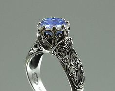 The ENCHANTED PRINCESS 14k gold engagement ring with 2.2ct natural Blue Sapphire