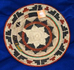 """A colorful finely woven large southwestern design basket. 14x2.5"""" Great for fruit or snacks, but so pretty, you could hang it on your wall as a decorative accent piece! $24.95 #basket #southwestern #homedecor #handwoven"""