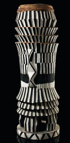 Africa   Large drum from the Mongo people of DR Congo   Made from a hollwed tree trunk, geometrical pattern painted with white and black pigment. Animal hide drum skin, attached with a band of plaited plant fibre and nails