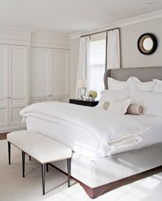wing bed, bench, built in closets, drapery detail