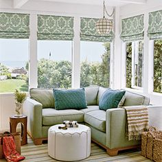 100 Comfy Cottage Rooms | Cozy Corner | CoastalLiving.com Sun room: corner sofa with foot stool. Moss green - soft tones / sea foam blue accents
