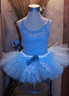 Princess Elsa Snow Queen Inspired From Walt Disney Movie Frozen  Half Marathon Running Adult Ladies Womens Fun Run Tutu Skirt. Disney World Disneyland Embellished Snowflakes Sparkly tulle ribbon waisted.  Perfect outfit for running or dress up with the little princess in your days! Great prices starting at $22!!!! Check out www.handpickedhandmade.etsy.com