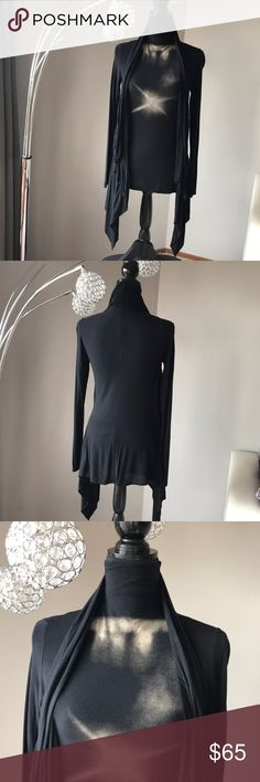 Black top with motif by Uber cool Spanish designer Black top with motif by Uber cool Spanish designer Isabel de Pedro. Long sleeves. Prob in front. Length from back of neck is 27in. Looks really cool with leggings or leather pants Isabel de Pedro Tops
