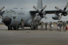 U.S. Air Force members from the 67th Fighter Squadron, Kadena Air Force Base, Japan, deplane a C-130 Hercules, on Komatsu Air Base, Japan, Dec. 7, 2013. The arrival of the C-130 is part of a week-long Aviation Training Relocation Program hosted by the Japanese Air Self Defense Force 6th Wing. (U.S. Air Force photo by Staff Sgt. Amber E. N. Jacobs)