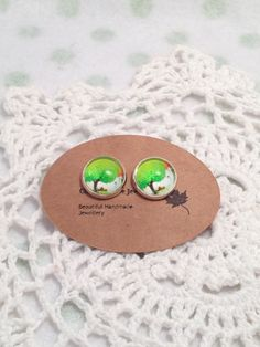 A personal favourite from my Etsy shop https://www.etsy.com/au/listing/265891274/stud-earrings-green-tree-whimsical-glass