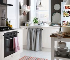A small kitchen with smart storage and a mobile worktop