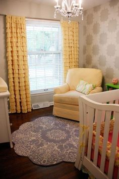 Love this nursery.  Ruffled curtains, wallpaper, chandelier.