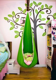 I love this idea for a kid's room with the tree and owl and I wonder if I could fit in the green hamper and hide!