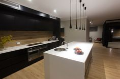 The Studio Platinum - OMG love this kitchen with hidden scullery behind, sink in bench and a BIG bench at that.