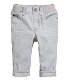 Gray. 5-pocket pants in cotton twill. Adjustable, ribbed elasticized waistband and fly with snap fastener.