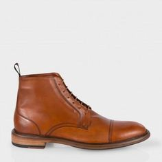 $675, Tan Leather Boots: Paul Smith Tan Calf Leather Fillmore Boots. Sold by Paul Smith. Click for more info: https://lookastic.com/men/shop_items/306577/redirect