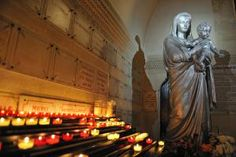 CandlesInCathedral_1500.jpg - Image by Sami Sarkis/Photographer's Choice/Getty Images