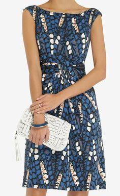 Printed Jersey Dress --- For a look that is comfortable, stylish and professional, choose a jersey dress in a fun print. Layer a coordinating blazer, neutral colored heels and some simple silver or gold jewelry to nail this look. --- For more professional advice on presentations, social media marketing, or branding, contact HugSpeak to learn about our services. www.HugSpeak.com