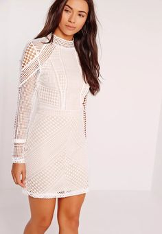 Channel your inner Kylie Jenner and totally work it in this high neck lace dress. This one of a kind piece features a structured high neck for an elegant, streamlined silhouette while the intricate lace detail looks perfect paired with the . High Neck Lace Dress, Short Lace Dress, Short Dresses, Little White Dresses, White Mini Dress, Shoulder Off, Inexpensive Wedding Dresses, Best Prom Dresses, Party Dresses