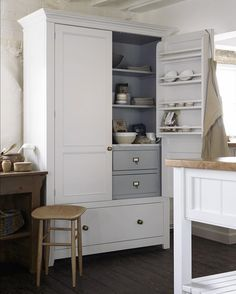 The Classic English Pantry Cupboard by deVOL; nothing surplus to requirement's, just a beautifully made solid hardwood cupboard, with solid Oak drawers all on soft close drawer runners. A lovely slab of Carrara marble and some very traditional brass handles are the finishing touches. #deVOLKitchens