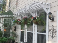 Wooden awning/pergola attached to siding