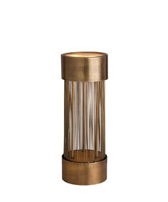 Berti 2L Solid Brass/Glass Table Lamp - Illuminate your room with fascinating transitional table lamps that serve both as illumination and as sculpture, and texture your world with metallic tones and flawless artisan construction. The Berti Table Lamp casts a soft, filtered illumination upward through its circular frosted glass top, a small torch atop a finely-barred cylindrical cage of antiqued brass rods to serve as a vertical accent among arrangements of transitional ornaments.