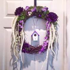 18 inch grapevine purple garden wreath. Has a birdhouse hanging from it and features butterflies, moss, and a bird's nest custom made by awreathforyouca