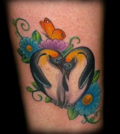 Penguin heart love butterfly flower tattoo by Tim Senecal of Easthampton, MA