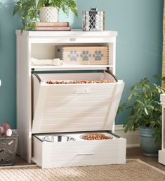 A great piece of furniture that fits into small homes, pet spaces or just about anywhere.  Food drawer pulls down, bowls pull out and there are shelves to store toys, treats or decorative items.  #doghouse #dogs #dogfood