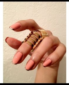 whatever these rows of rings are, they're cool, and I like 'em. And, the nails are fabulous with the gold tips!