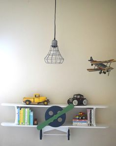 A boy bedroom with a transportation and vintage theme. Bright and bold colors and patterns make this a fun setting for kids to play. Many DIY projects and furniture builds are in this room. Making the toy organization work well. A lego table and DIY built in bunk beds help this room have a custom feel.