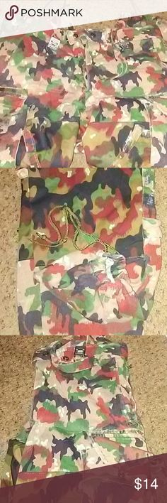 """Means Army Surplus Camo Cargo Pants /36"""" Camoflauge surplus pants. So many details that in not sure of what there for or their purpose. Suspenders and clips. Straps around large side pockets that adjust. Two rows  of heavy duty snaps on the calf section of pants with adjustable straps. Adjustable snaps at waist area. Buttonfly. Tag inside says 46-76 and 74-76. Not sure the meaning but the waist measures at 36"""" and inseam is 28"""". Bottoms have drawstring and can pull the bottoms tight Army…"""