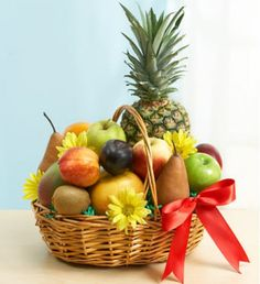 Delightfully deluxe -- that 's our abundant basket of fresh fruit, selected and hand-packaged by our florists to show your good taste on any occasion. Fruits such as kiwis, pineapples, grapefruits, apples or plums are beautifully arranged and accented with fresh daisies.