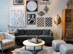 dwell flagship / gray sofa/ marble & brass cocktail table / white brick wall