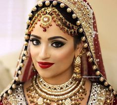 A bold and traditional wedding look with amazing jewelry and I always love this type of · Arabic Wedding DressesBridal MakeupWedding ...