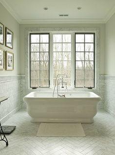 Chevron tile floors, awesome tub, window trim...white sooo nice!