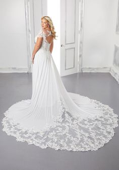 A-line chiffon wedding dress with v-neck neckline and cap sleeves. Plus Size Bridal Dresses, Plus Size Wedding Gowns, Wedding Dresses Photos, Bridal Wedding Dresses, Wedding Dress Styles, Gown Gallery, Designer Bridesmaid Dresses, Gown Photos, Dress Out