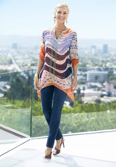 This sheer, long tunic is packed with personality. From the whimsical print to gold sequins and an asymmetrical hem, this top is made to be seen.