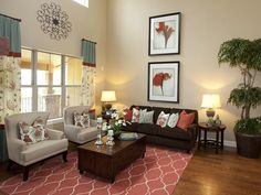 Touch of Coral Living Room Furnishings: A coral-colored rug pulls together the design in this living room, uniting the pops of color found in the curtains, artwork, and pillows. The neutral chairs and sofa blend into the background and let the coral and turquoise elements shine. From HGTVRemodels.com