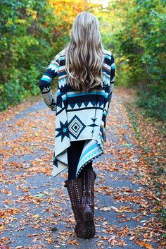 These cold fall nights call for cozy layers. Wrap up in the Navajo Nation Cardi, a knit drape open front cardigan with trendy tribal print.