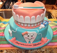 Obsessed with this dental hygiene school graduation cake!