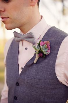 succulent and pink boutonniere. Coral tie instead.