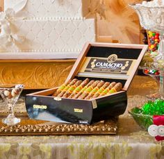 caramel chocolate-covered pretzels rolled in beer batter toffee and displayed in a cigar box.
