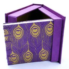 Clamshell boxes are custom-fit cases made for a precious bound book or set of books. They provide a stylish and professional appearance, while offering the necessary protection against harmful light, dirt, and usual wear. Follow this tutorial to learn how to make your own cozy clamshell book box. | Tags: Bookbinding, Binder's Board, Bone Folder, Knife, Paper