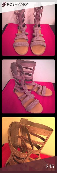 🆕 Fergalicious Zaille Gladiator Sandals Statement Sandals that frame your Legs with Great Style! Authentic Fergalicious by Fergie Zaille Gladiator Sandals. True to Size. Color: Taupe. Textile Upper. The Rest is Manmade. Open Toe. Back-Zip Closure. Braided Details. Low Heel. 9-inch Shaft. Very Lightweight. Brand New. Excellent Condition. No Trades. Fergalicious Shoes Sandals