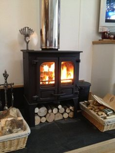 Charnwood Island II on log store, twin wall flue and eco fan.