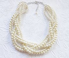 This beautiful braided statement necklace is made with 6mm and 8mm ivory glass pearls. It would be perfect for bridal party, or a special evening!