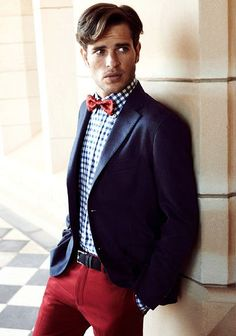 Men's street style fashion: Navy suit jacket blazer, red trouser pants, checked shirt, red bowtie