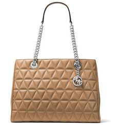 Scarlett Large Quilted Tote Bag by MICHAEL Michael Kors. MICHAEL Michael Kors quilted lambskin leather tote bag. Golden hardware. Chain and leather top handles. Hanging logo ...