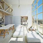 The northern facade of this affordable beach house in Chile, takes in the water views via double-height windows in the main living room, ...