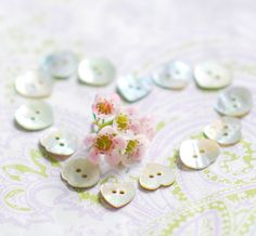(::)  pearly buttons arranged in a heart shape